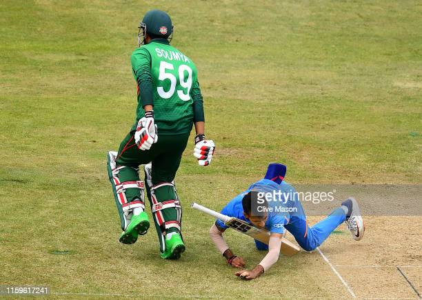 Yuzvendra Chahal of India is hit in the face by the bat of Soumya Sarkar of Bangladesh during the Group Stage match of the ICC Cricket World Cup 2019...