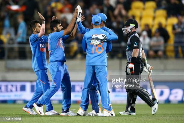 Yuzvendra Chahal, Shardul Thakur, Virat Kohli and KL Rahul of India celebrate after taking the wicket of Tim Seifert of New Zealand during game four...