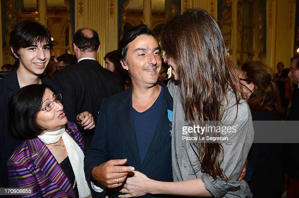 Yvan Attal pose with Charlotte Gainsbourg his son Ben and his mother after being honored 'Chevalier de l'Ordre National du Merite' by the French...