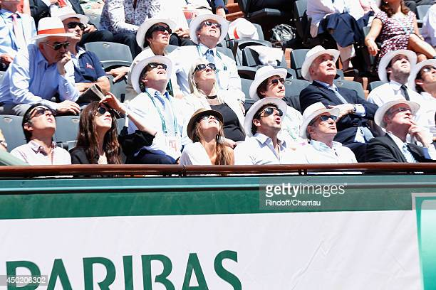Yvan Attal with Charlotte Gainsbourg, Patrick Bruel with a friend, Michel Drucker and CIO President Thomas Bach attend the Roland Garros French...