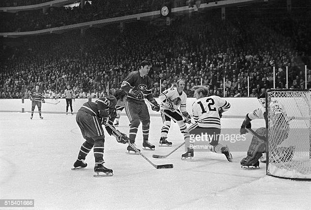 Yvan Cournoyer of Montreal scores the first Canadiens' goal in first period in Chicago Stadium as he gets shot past Black Hawks goalie Tony Esposito...