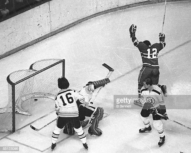 Yvan Cournoyer of the Montreal Canadiens celebrates his goal on goalie Gerry Cheevers and Derek Sanderson of the Boston Bruins circa 1970's at the...