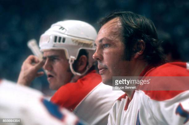Yvan Cournoyer of the Montreal Canadiens sits on the bench during an NHL game circa 1974 at the Montreal Forum in Montreal Quebec Canada