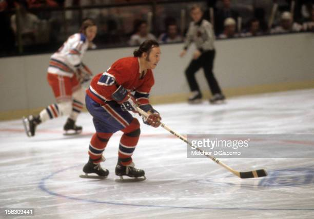 Yvan Cournoyer of the Montreal Canadiens skates with the puck during an NHL game against the New York Rangers circa 1972 at the Madison Square Garden...