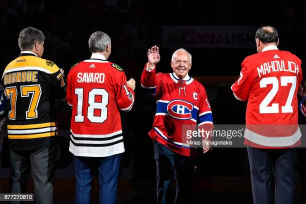 Yvan Cournoyer salutes the fans as he walks towards centre ice to join Raymond Bourque Denis Savard and Frank Mahovlich during the pregame ceremony...