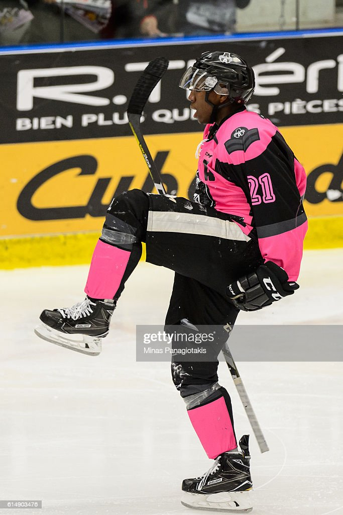 Yvan Mongo #21 of the Blainville-Boisbriand Armada celebrates his third period goal during the QMJHL game against the Halifax Mooseheads at the Centre d'Excellence Sports Rousseau on October 15, 2016 in Boisbriand, Quebec, Canada. The Blainville-Boisbriand Armada defeated the Halifax Mooseheads 4-2.