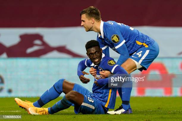 Yves Bissouma and Joel Veltman of Brighton and Hove Albion celebrate following their team's victory in the Premier League match between Aston Villa...