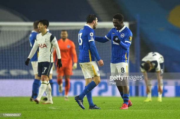 Yves Bissouma and Pascal Gross of Brighton & Hove Albion celebrate their side's victory after the Premier League match between Brighton & Hove Albion...