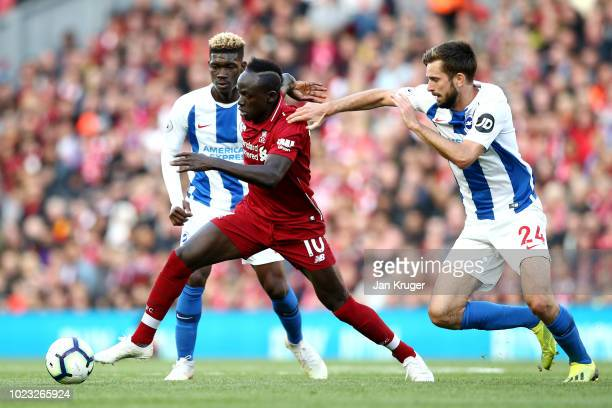 Yves Bissouma of Brighton and Hove Albion and Davy Proepper of Brighton and Hove Albion battles for posession with Sadio Mane of Liverpool during the...
