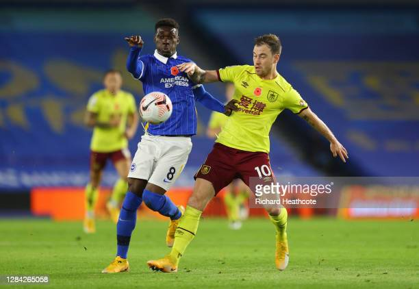 Yves Bissouma of Brighton and Hove Albion battles for possession with Ashley Barnes of Burnley during the Premier League match between Brighton &...