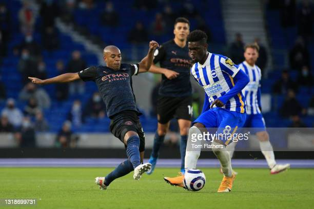 Yves Bissouma of Brighton and Hove Albion battles for possession with Fernandinho of Manchester City during the Premier League match between Brighton...