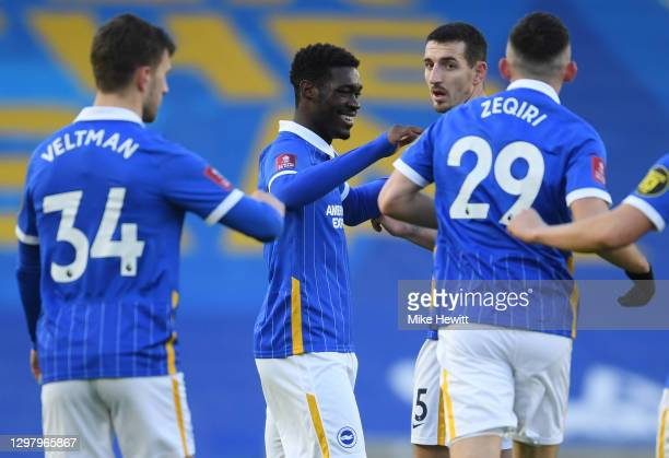 Yves Bissouma of Brighton and Hove Albion celebrates with teammate Lewis Dunk after scoring his team's first goal during The Emirates FA Cup Fourth...