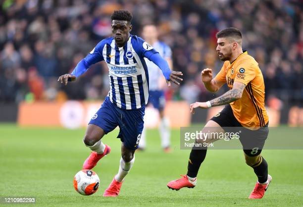 Yves Bissouma of Brighton and Hove Albion gets away from Ruben Neves of Wolverhampton Wanderers during the Premier League match between Wolverhampton...