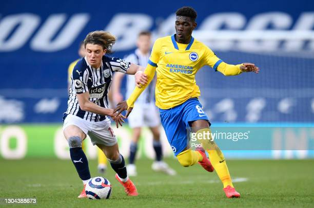 Yves Bissouma of Brighton and Hove Albion is challenged by Conor Gallagher of West Bromwich Albion during the Premier League match between West...