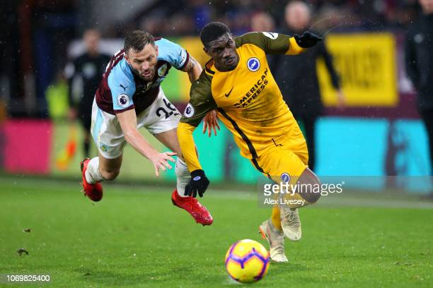 Yves Bissouma of Brighton and Hove Albion is challenged by Phillip Bardsley of Burnley during the Premier League match between Burnley FC and...