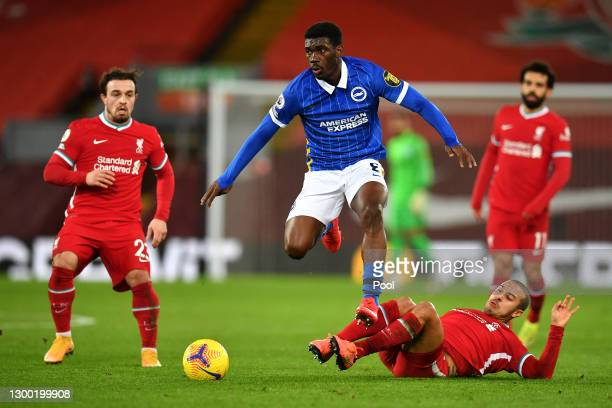 Yves Bissouma of Brighton and Hove Albion is challenged by Thiago Alcantara of Liverpool as Xherdan Shaqiri of Liverpool looks on during the Premier...