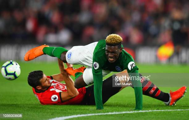 Yves Bissouma of Brighton and Hove Albion is tackled by Wesley Hoedt of Southampton during the Premier League match between Southampton and Brighton...