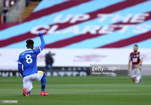 Yves Bissouma of Brighton and Hove Albion takes a knee in support of the Black Lives Matter movement prior to the Premier League match between...