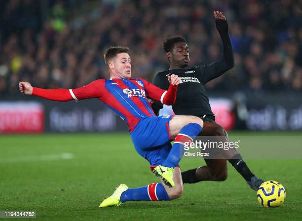 Yves Bissouma of Brighton battles for possession James McCarthy of Crystal Palace during the Premier League match between Crystal Palace and Brighton...