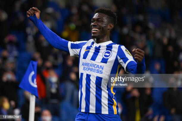 Yves Bissouma of Brighton & Hove Albion interacts with the crowd at the end of the Premier League match between Brighton & Hove Albion and Manchester...