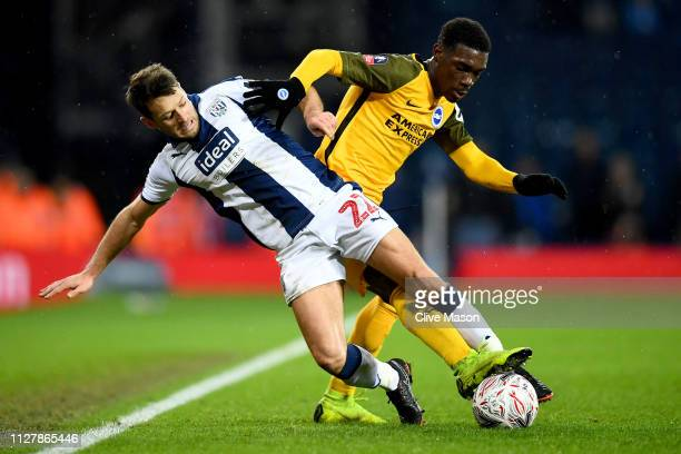 Yves Bissouma of Brighton & Hove Albion is challeneged by Wes Hoolahan of West Bromwich Albion during the FA Cup Fourth Round Replay match between...