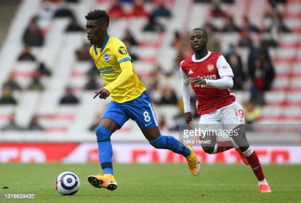 Yves Bissouma of Brighton & Hove Albion is put under pressure by Nicolas Pepe of Arsenal during the Premier League match between Arsenal and Brighton...