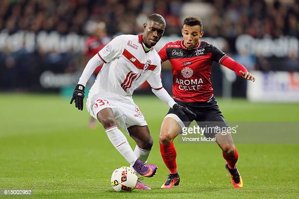 Yves Bissouma of Lille an Marcal of Guingamp during the Ligue 1 match between EA Guingamp and Lille OCS at Stade du Roudourou on October 15, 2016 in...