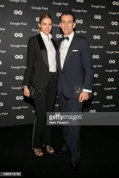 Yves Bougon and a guest attend GQ Men Of The Year Awards 2018 at Centre Pompidou on November 26 2018 in Paris France