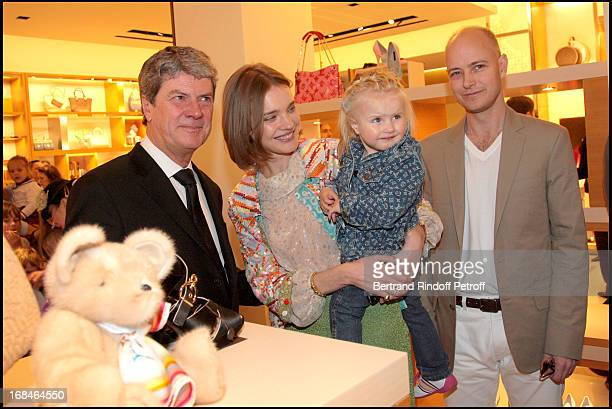 Yves Carcelle and Natalia Vodianova with husband Lord Justin Portman and daughter Neva at The Reopening Of Louis Vuitton Store In Moscow In...