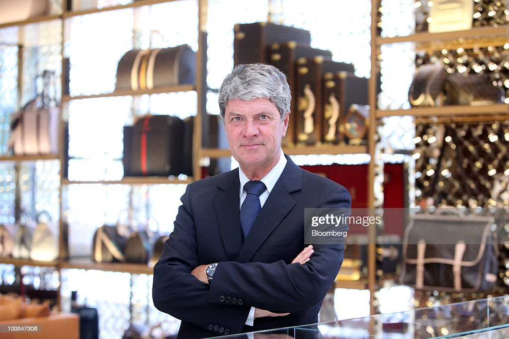 Yves Carcelle, chief executive officer of Louis Vuitton, poses for a photograph at the Louis Vuitton 'maison,' the flagship store for LVMH Moet Hennessy Louis Vuitton SA, in New Bond Street in London, U.K., on Tuesday, May 25, 2010. The new London LV maison has been designed by the New York-based architect, Peter Marino, who also worked on the brand�s Champs Elysees maison. Photographer: Chris Ratcliffe/Bloomberg via Getty Images