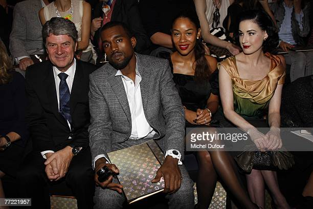 Yves Carcelle Kanye West and his wife Dita von Teese attends the Louis Vuitton fashion show during the Spring/Summer 2008 readytowear collection show...