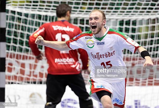 Yves Grafenhorst of Magdeburg celebrates after scoring during the Toyota Handball Bundesliga match between SC Magdeburg and Rhein Neckar Loewen at...