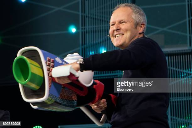 Yves Guillemot chief executive officer of UbiSoft Entertainment SA poses on stage while announcing the Mario Rabbis Kingdom Battle video game during...