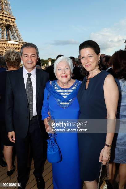 Yves Levy Line Renaud and Agnes Buzyn attend Line Renaud's 90th Anniversary on July 2 2018 in Paris France