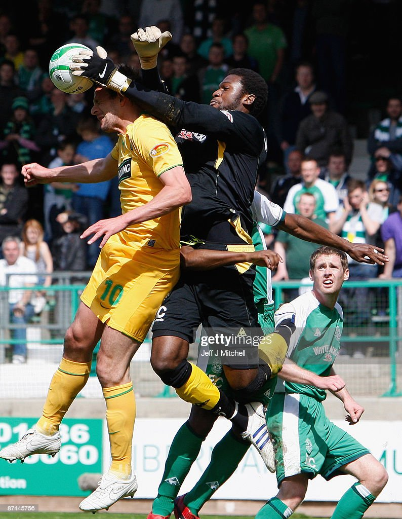 Yves Ma-Kalambay of Hibernian challenges Jan Vennegoor of Hesselink of Celtic during the Scottish Premier League match between Hibernian and Celtic at Easter Road on May 17, 2009 in Edinburgh, Scotland.