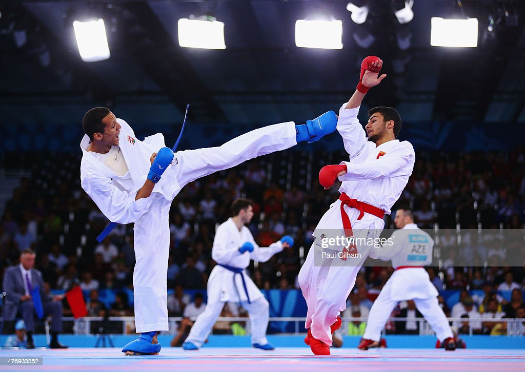Yves Martial Tadissi of Hungary (L) and Burak Uygur of Turkey compete in the Men's -67kg Kumite elimination during day one of the Baku 2015 European Games at Crystal Hall on June 13, 2015 in Baku, Azerbaijan.