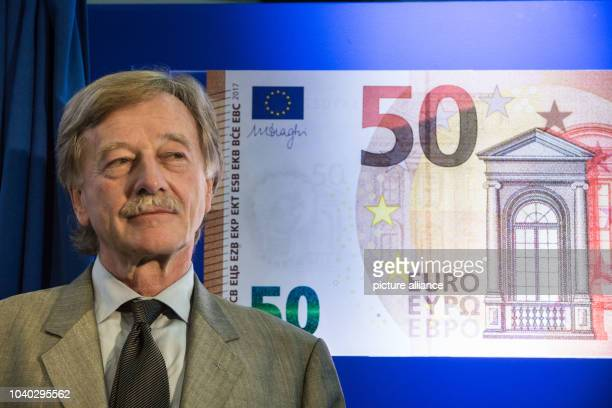 Yves Mersch member of the directory of the European Central Bank standing in front of a display of the new 50 Euro bank note at the headquarters of...