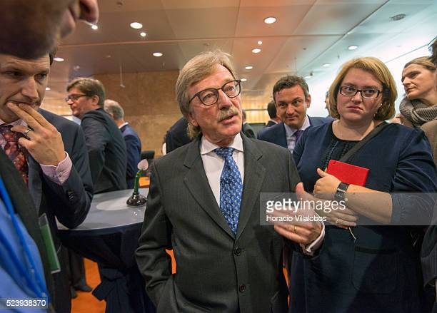Yves Mersch member of the ECB's Executive Board departs with journalists after having presided over the unveiling of the new ten euros banknote of...