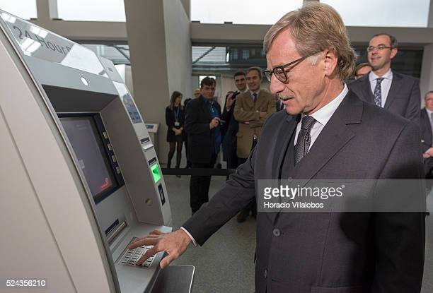 Yves Mersch member of the ECB's Executive Board receives the first 20 euros banknote through an ATM at the official event hosted by the European...
