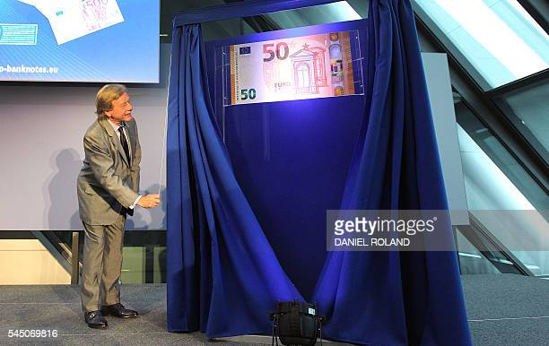 Yves Mersch Member of the Executive Board of the European Central Bank ECB unveils the new 50 EURO banknote at the ECB in Frankfurt am Main central...
