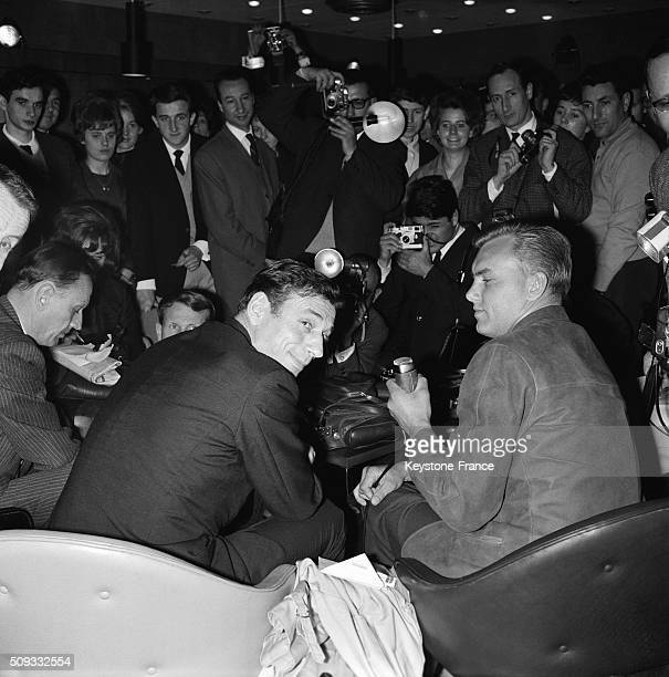 Yves Montand At Paris Orly Airport Back From Japan With Journalist Christian Brincourt in Orly France on May 26 1962