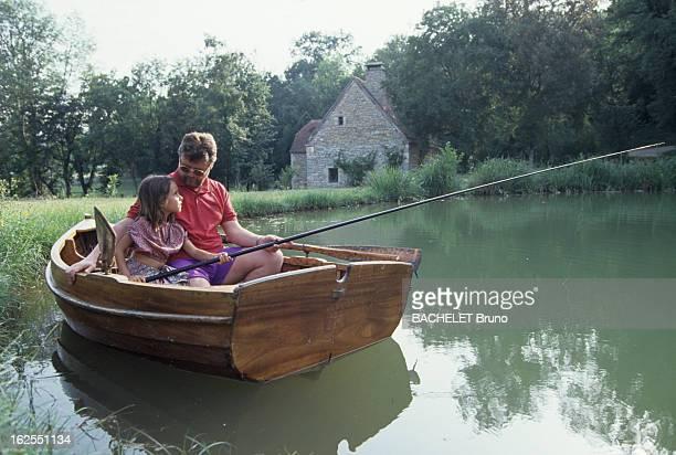 Yves Mourousi And His Daughter Sophie At Alain Dominique Perrin Her Godfather Dans le lot au château Lagrezette sur un plan d'eau de son château...