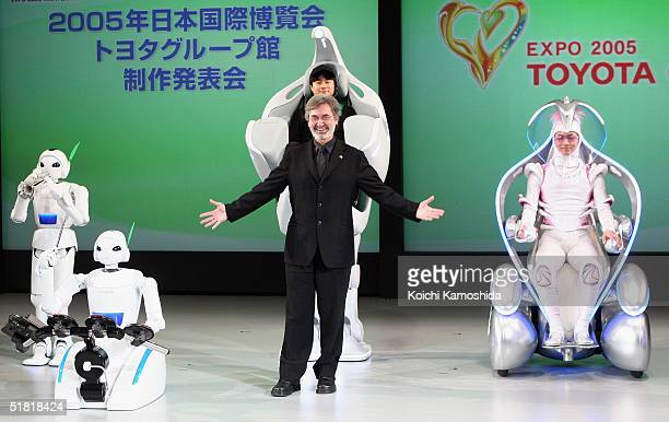 Yves Pepin Producer/Show Director of 'EXPO 2005 AICHI' poses next to the companies newly developed prototype of a rolling robot during a press...