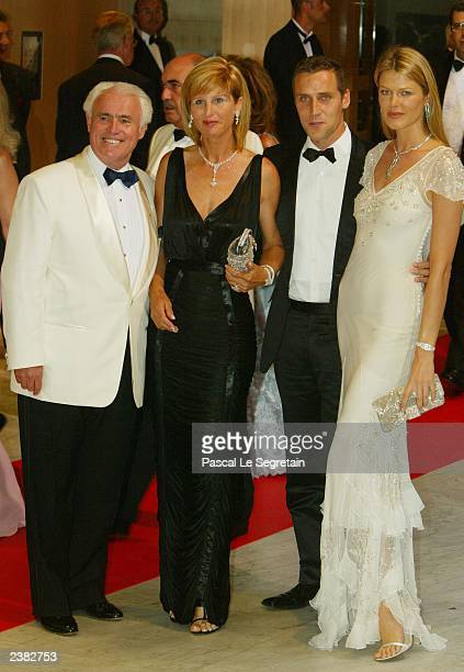 Yves Piaget his wife Jean Baptiste Vieira and his girlfriend Ingrid arrive at the 55th Red Cross gala dinner August 8 2003 in Monte Carlo Monaco The...