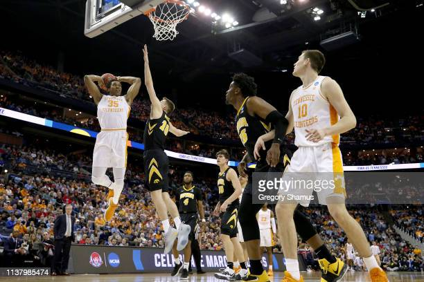 Yves Pons of the Tennessee Volunteers looks to dunk the ball against the Iowa Hawkeyes during their game in the Second Round of the NCAA Basketball...