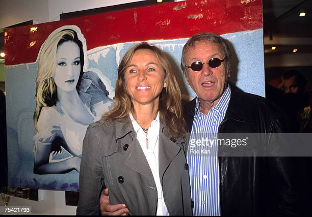 Yves Renier and His Wife Karine attend The Jean Daniel Daniel Lorieux's Paintings Exhibition Cocktail at the Salons Jacques Dessanges on June 18,...