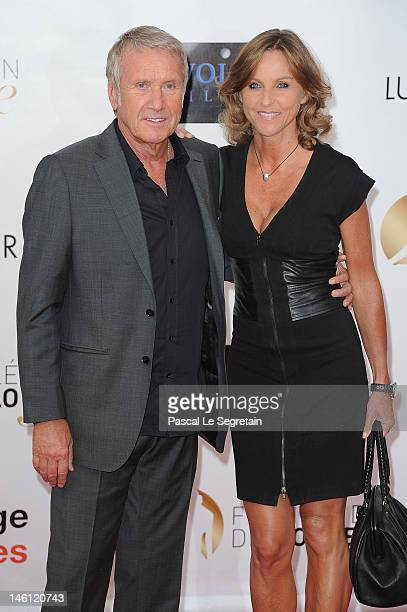 Yves Renier and wife Karine arrive at the opening ceremony of the 2012 Monte Carlo Television Festival held at Grimaldi Forum on June 10, 2012 in...