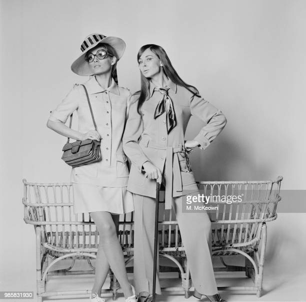 Yves Saint Laurent inspired safari outfits by Wallis fashion model Emma Vincent wearing long shirt over sidewrapped skirt and straw hat by Edward...