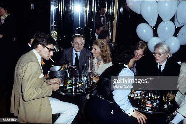 Yves Saint Laurent Pierre Berger and Andy Warhol at a party in le Palace in 1977 in Paris France