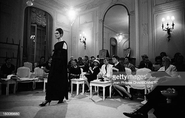 Yves Saint Laurent watching a model at Christian Dior 1960 in Paris France